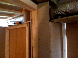 Door frame air duct with chipboard covering