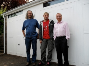 Three dodgy blokes, loitering outside a garage